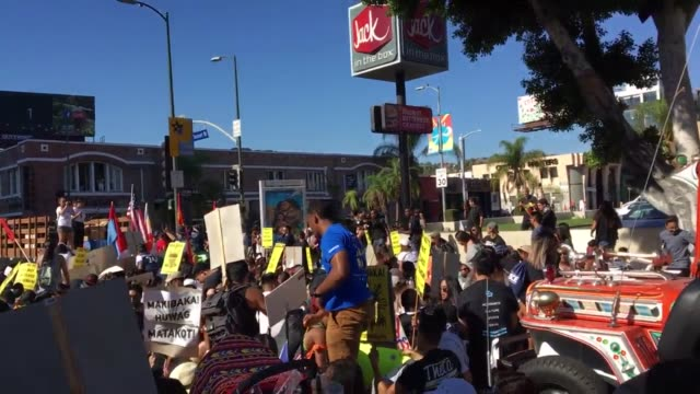 filipino community marching for injustices against filipino veterans by the united states government and solidarity with anti trump supporters - us republican party 2016 presidential candidate stock videos & royalty-free footage