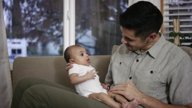 Filipino Father Lovingly Holding his Mixed-Race Baby Girl
