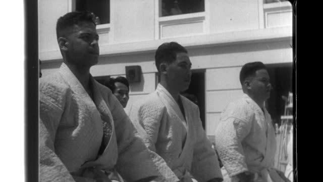 Filipino police officers of the Manila Police Department learn Judo from Japanese teachers