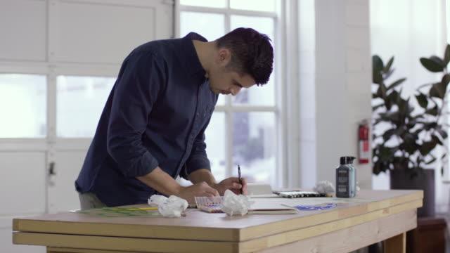 Filipino Young Man Sketching at a Drawing Table