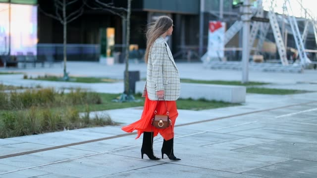 Filippa Haegg is seen wearing brown Chloe bag black boots orange skirt checked blazer jacket outside Resume during the Copenhagen Fashion Week...