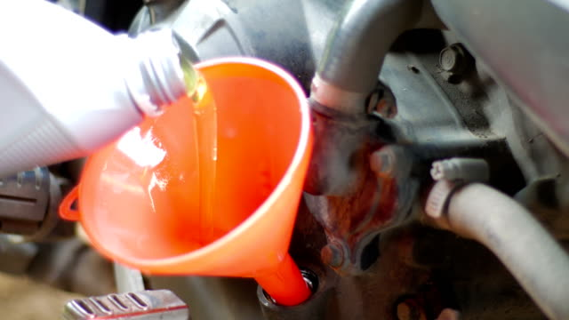 Fill lubricant oil to motorcycle engine, maintenance service