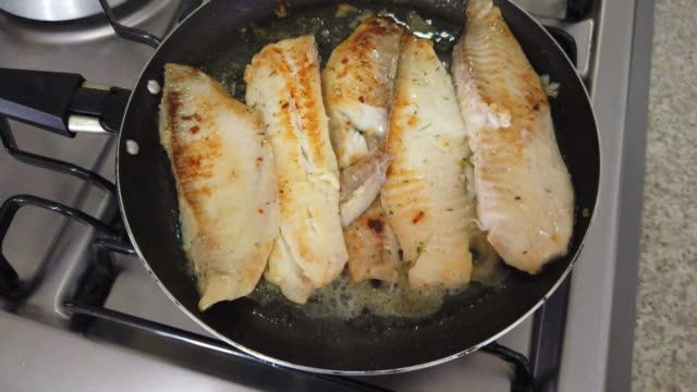 fillets of fish on a frying pan - cooking pan stock videos & royalty-free footage