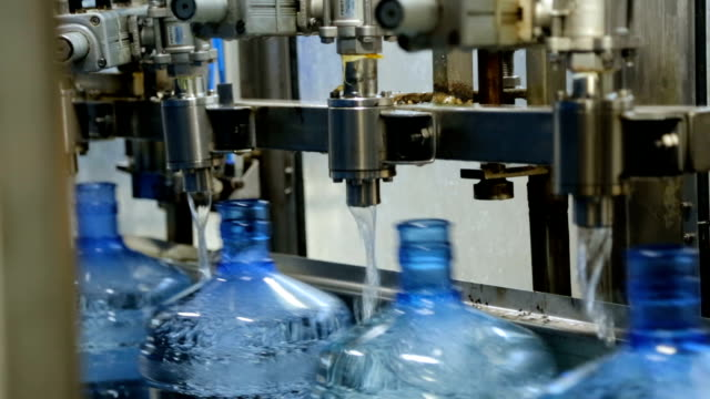 filling bottle with water in factory - cooler container stock videos and b-roll footage