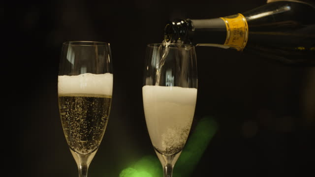 filling champagne flutes - champagne flute stock videos & royalty-free footage