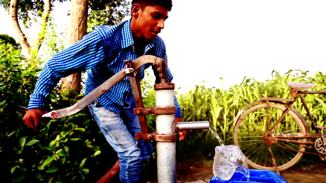 filling fresh water in the container - water pump stock videos & royalty-free footage