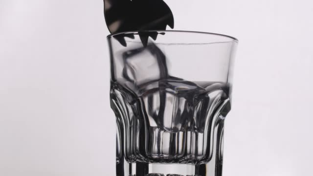 CU Filling Ice Cube Into Empty Glass.