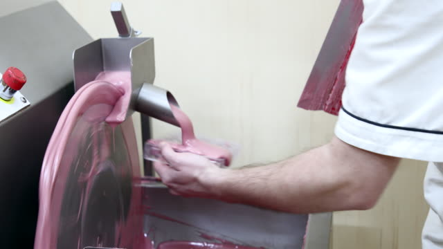 filling molding cast with leaking ruby chocolate - confectionery stock videos & royalty-free footage