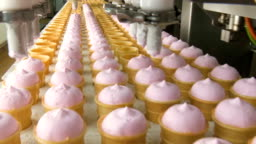 Filling of wafer cups with ice cream.