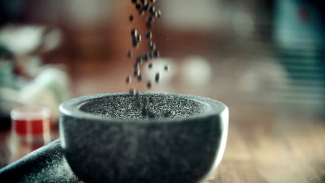 filling peppercorns into mortar and pestle - mortar and pestle stock videos and b-roll footage