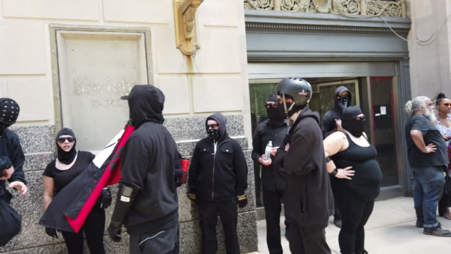 antifa fills up a sidewalk hundreds of counter protesters including the nation of islam the dayton chapter of the black panthers and huey p newton... - ku klux klan stock videos and b-roll footage