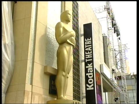 2004 Oscars Preview Spotlight pushed along Technical crew sorting equipment in preparation for 2004 Academy Awards ceremony Academy Awards sign Oscar...