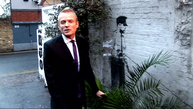 academy award nominations: documentary by banksy receives nomination; london: ext reporter to camera graffiti art stencil on wall by banksy... - stencil stock videos & royalty-free footage