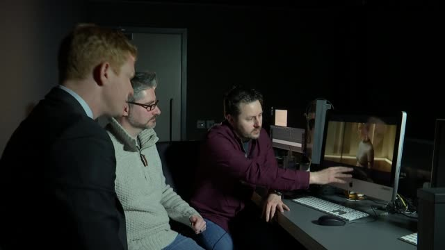 oscars preview: 'visual effects' nominees double negative; mark ardington and paul norris set-ups talking with reporter in edut suite/ mark ardington... - film negative stock videos & royalty-free footage
