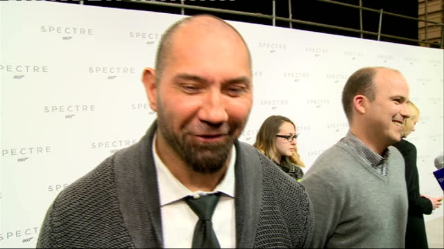 24th james bond film to be called 'spectre' cast unveiled bautista as interviewed by press with ralph fiennes in background / dave bautista interview... - skyfall stock videos and b-roll footage