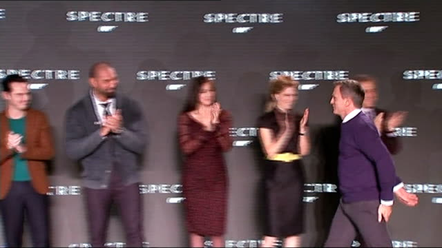 24th james bond film to be called 'spectre' england west london pinewood studios photography*** daniel craig onto stage and shakes hands and hugs sam... - james bond fictional character stock videos and b-roll footage
