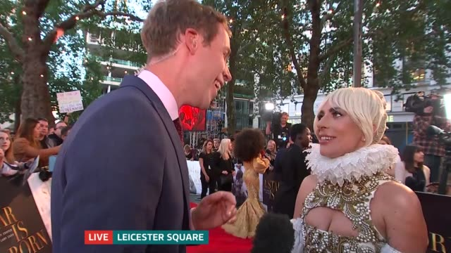 stockvideo's en b-roll-footage met 'a star is born' premiere england london leicester square ext lady gaga live interview on red carpet sot - première