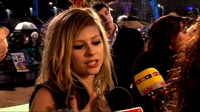 Alice in Wonderland London premiere red carpet arrivals Avril Lavigne talking to press and interview SOT Unidentified arrivals Jemma Powell talking...