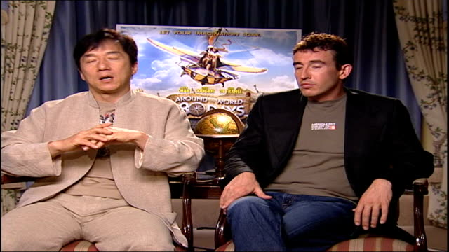 around the world in 80 days; itn england: london: int coogan interviewed sot - they are always looking for the next person jackie chan interviewed... - jackie chan stock videos & royalty-free footage