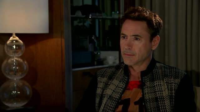 avengers age of ultron robert downey jr interview robert downey jr interview sot re parallels between himself and iron man character - クリシュナン・グルマーフィ点の映像素材/bロール