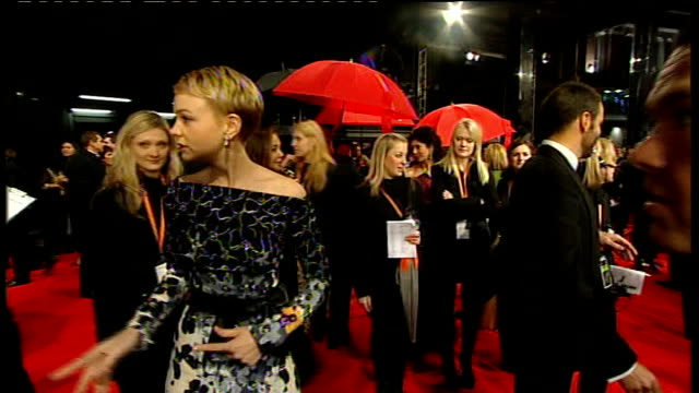 film awards 2010: red carpet arrivals and interviews ; general view andy serkis and wife speaking to press on red carpet carey mulligan on red... - andy serkis stock videos & royalty-free footage