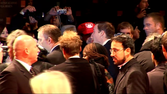 film awards 2010: red carpet arrivals ; andy serkis and wife along on red carpet long shot prince william shaking hands with people in crowd prince... - andy serkis stock videos & royalty-free footage