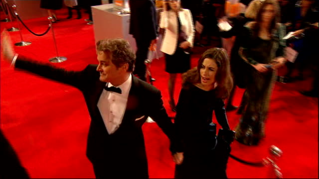 stockvideo's en b-roll-footage met 'king's speech' triumphs england london royal opera house actors and celebrities on red carpet baftas posters colin firth arriving with livia... - bafta awards
