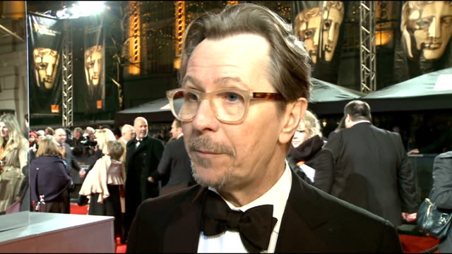 film awards 2012: celebrity arrivals; gary oldman interview sot - on what the baftas mean to him / on the new batman film - going to be a cracker,... - epic film stock videos & royalty-free footage