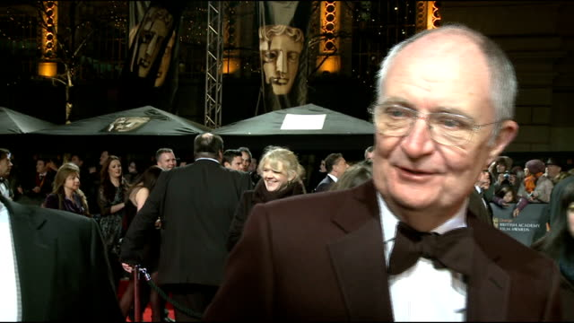 celebrity arrivals jim broadbent interview sot on what the baftas mean to him / whether meryl streep will win / whether criticism of 'the iron lady'... - christina hendricks stock videos and b-roll footage