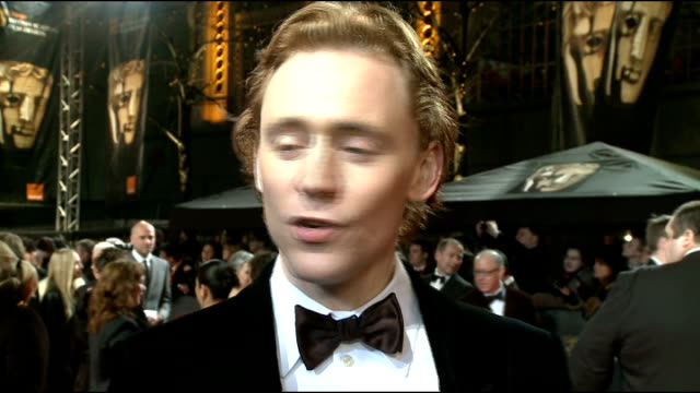 celebrity arrivals side view tom hiddleston speaking to press / brief shot tom hooper along tom hiddleston interview sot on being nominated for a... - brad pitt actor stock videos and b-roll footage