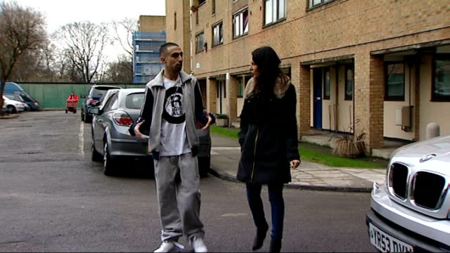 Hackney EXT Adam Deacon walking with reporter Lucrezia Millarini Deacon along to official