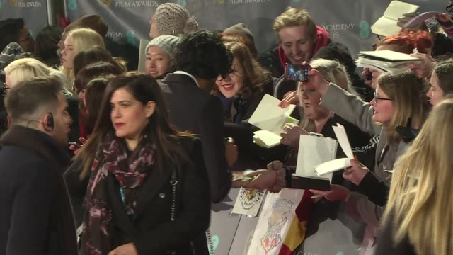 red carpet arrivals BAFTA Film Awards 2017 red carpet arrivals Emily Blunt along signing autographs / Dev Patel along signing autographs / Emma Stone...