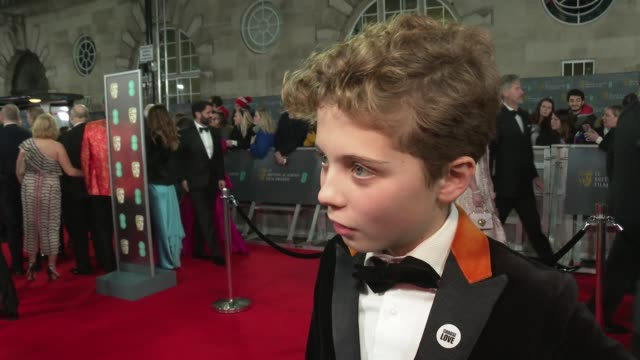 red carpet arrival and interviews england london royal albert hall bafta film awards ext roman griffin davis interview sot / kaitlyn dever posing for... - al pacino stock videos & royalty-free footage