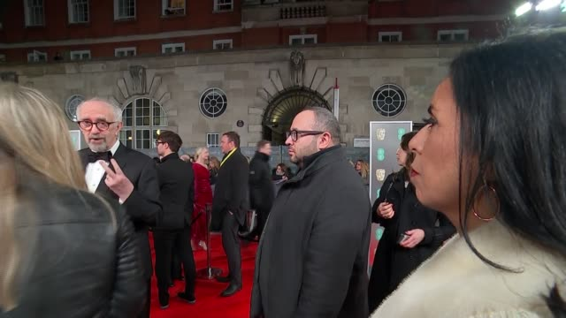 film awards 2020: red carpet arrival interviews; england: london: royal albert hall: bafta film awards 2020: ext / night jonathan pryce talking to... - ジョナサン・プライス点の映像素材/bロール