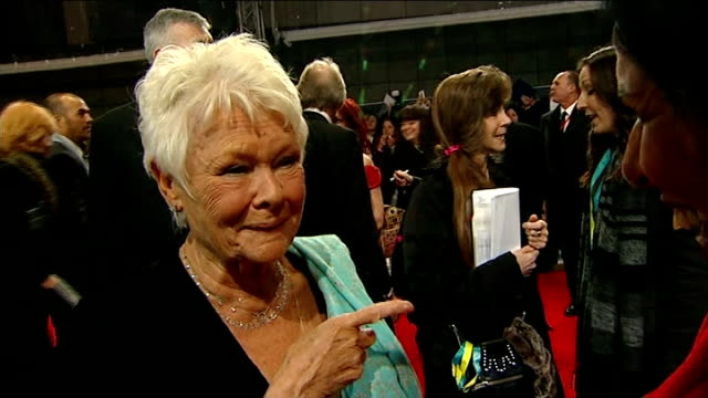 bafta awards 2014; dame judi dench interview sot - it never used to be like this, used to be rather quiet with a few people standing at the front... - ジュディ・デンチ点の映像素材/bロール