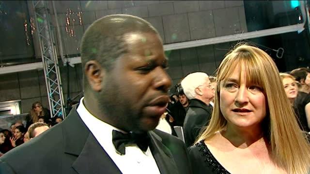 Bafta Awards 2014 Red Carpet ENGLAND London John Ridley interview SOT / Steve McQueen SOT / Will Poulter chatting to press / Daniel Bruhl SOT /...