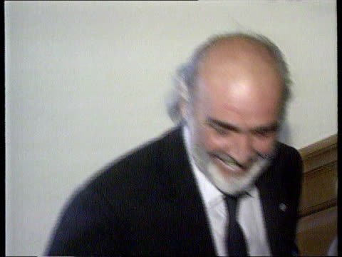 arrivals:; itn england: london: cms sean connery up stairs at ceremony tx 19.4.98/18.15 - sean connery stock videos & royalty-free footage