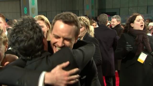 BAFTA Film Awards 2016 Matt Damon signing autographs for fans British actor Idris Elba along on red carpet Actors embracing on red carpet Kate...