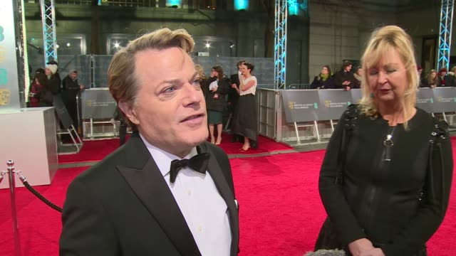 BAFTA Film Awards 2016 Red carpet arrivals Eddie Izzard interview SOT / Matt Damon along to sign autographs and pose for photos for fans / Actor...