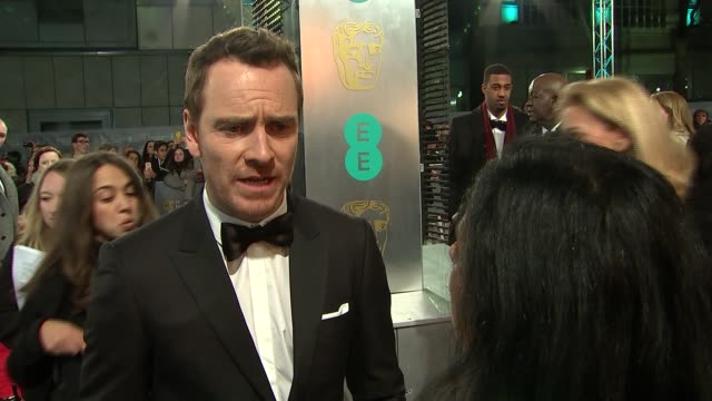 bafta film awards 2016 red carpet arrivals michael fassbender interview sot / back view kate winslet along / unidentified people / winslet and... - kate winslet stock videos and b-roll footage