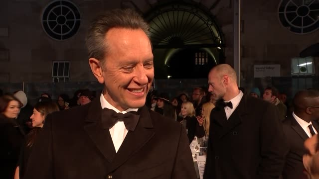 film awards 2019: red carpet interviews; england: london: kensington: the royal albert hall: ext richard e grant and cynthia erivo on red carpet /... - richard e. grant stock videos & royalty-free footage