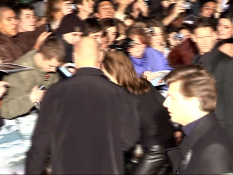 'Beowulf' premiere arrivals and interviews Back view Angelina Jolie signing autographs for fans