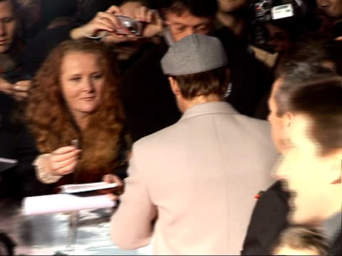 'beowulf' premiere arrivals and interviews back view brad pitt signing autographs for fans / back view angelina jolie and brad pitt on red carpet... - brad pitt actor stock videos and b-roll footage