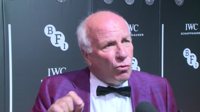 stockvideo's en b-roll-footage met bfi luminous gala dinner arrivals england london photography** greg dyke speaking to press and interview sot / jonathan pryce posing and interview... - terry gilliam