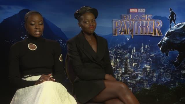 'black panther' junket interviews england london int danai gurira and lupita nyong'o interview sot - danai gurira stock videos and b-roll footage