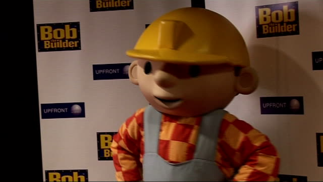 'bob the builder' premiere in london: celebrity arrivals; **beware flash photography** man dressed up as 'bob the builder' posing for photocall /... - premiere stock videos & royalty-free footage