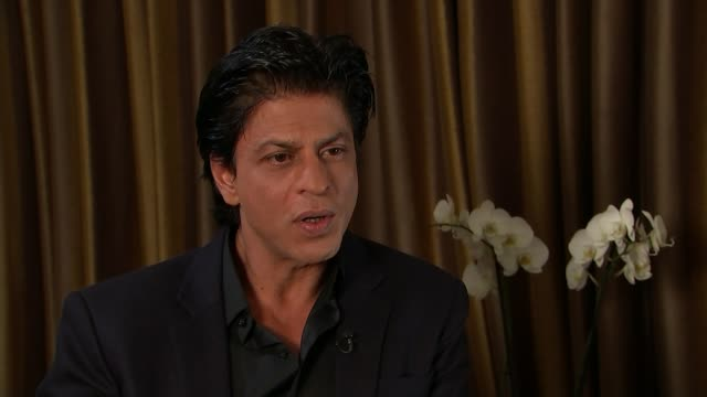 bollywood actor shah rukh khan interview england london int shah rukh khan interview sot - bollywood stock videos and b-roll footage