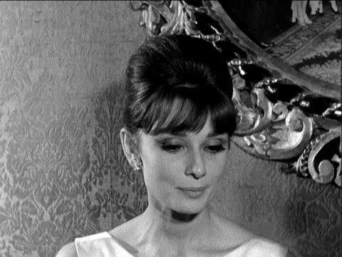 'breakfast at tiffany's': audrey hepburn interview; country town library issue no, event year england: london: plaza theatre: audrey hepburn... - audrey hepburn stock videos & royalty-free footage
