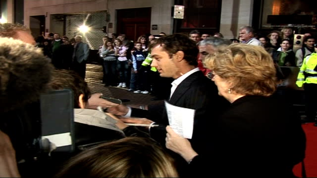 'breaking and entering' london premiere arrivals vars jude law signing autographs - 2006 stock videos & royalty-free footage