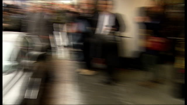 brit ekalnd at james bond blu ray launch; england: london: oxford street: hmv: ext general views of reporters / aston martin along onto pavement /... - window box stock videos & royalty-free footage
